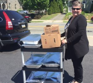 Sterling Director of Admissions Patricia O'Hara, loading food for delivery.